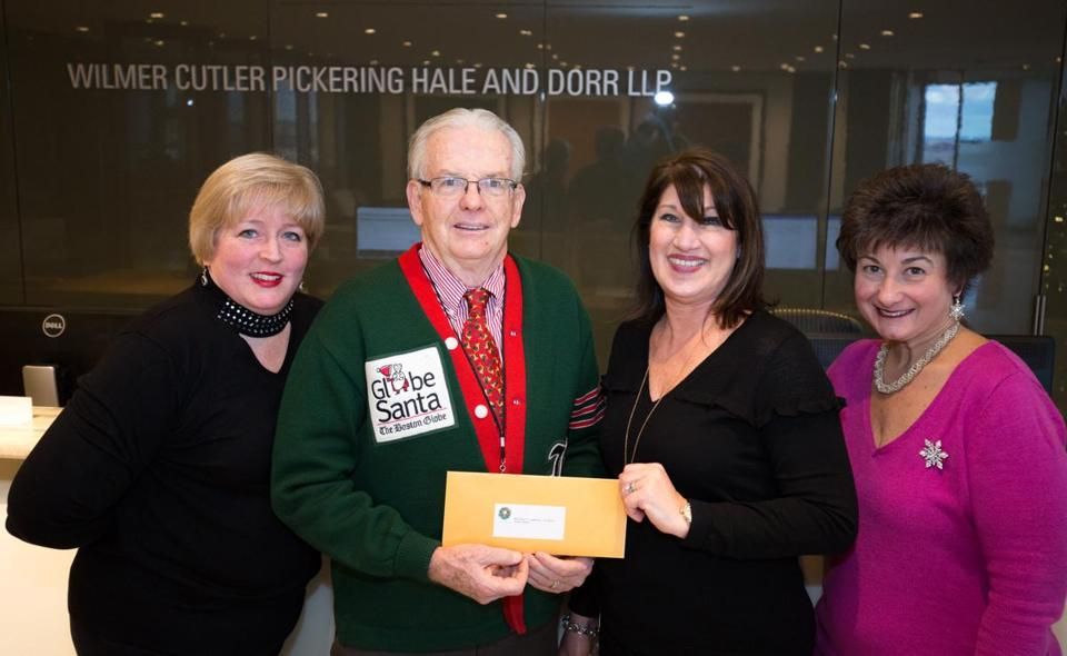 Marla Smith (left), Cheryl LoMaglio-Puleio, and Rose Coviello (right) joined Globe Santa executive director Bill Connolly to give him a donation of $1,352 from the law firm of Wilmer, Cutler, Pickering, Hale, and Dorr LLP.