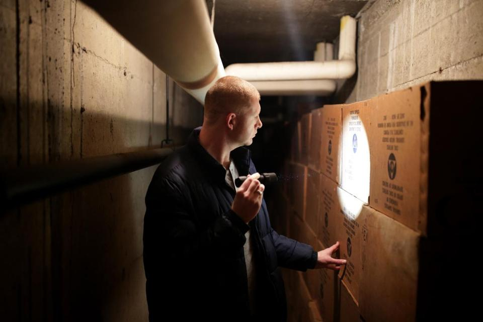 Sean Colby is an amateur historian on Civil Defense fallout shelters. He got a look at Civil Defense crackers that have been stored since the 1960s at Up Academy in South Boston.