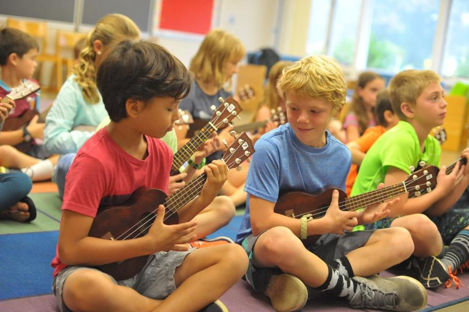 Scituate's fourth and fifth graders are learning to play the ukulele as part of a new elementary school music program.