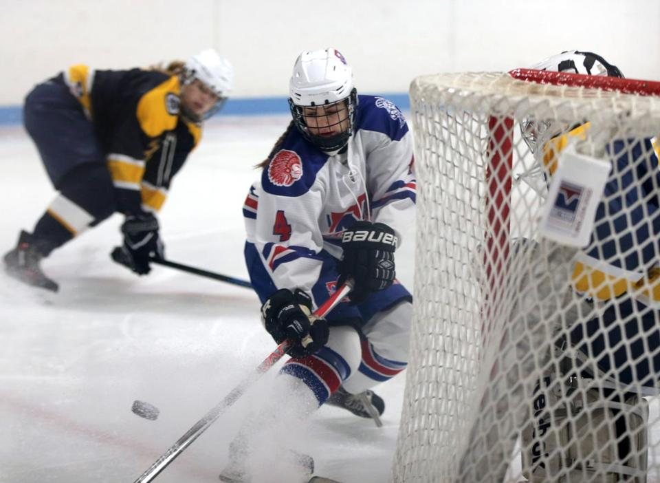 12/23/2017 Methuen Ma-. Methuen-Tewksbury player #4 Cassidy Gruning (cq) looks to gain control of puck during game action. Notre Dame Academy vs Methuen-Tewksbury Girls Ice Hockey. Jonathan Wiggs /Globe Staff Reporter:Topic.