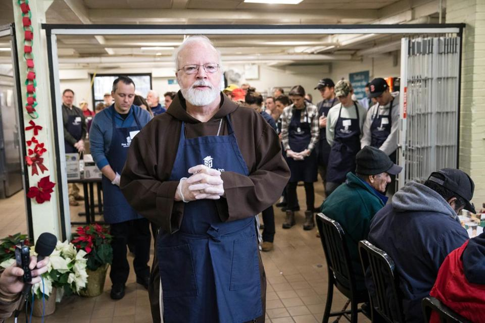 12/24/2017 BOSTON, MA Cardinal Se‡n O'Malley (cq) offered a blessing during the Christmas Eve Luncheon held at the Pine Street Inn in Boston. (Aram Boghosian for The Boston Globe)