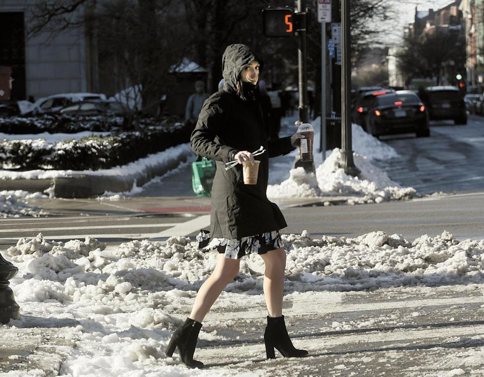 An iced coffee person in the Back Bay on Tuesday.