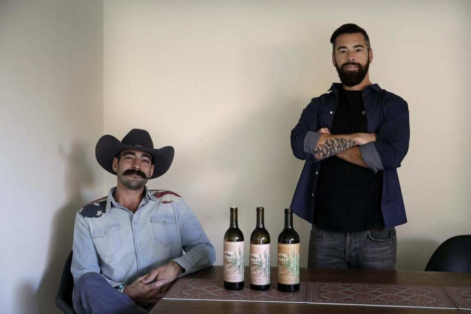 Alex Howe (right), and Chip Forsythe, the cofounders of Rebel Coast, with their cannabis-infused wine in Los Angeles. Each bottle of thier product contains 16 milligrams of THC.