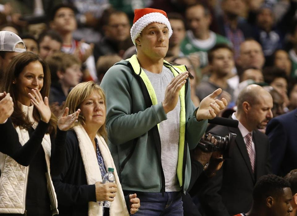 Patriots tight end Rob Gronkowski and his mom at the Celtics game on Christmas.