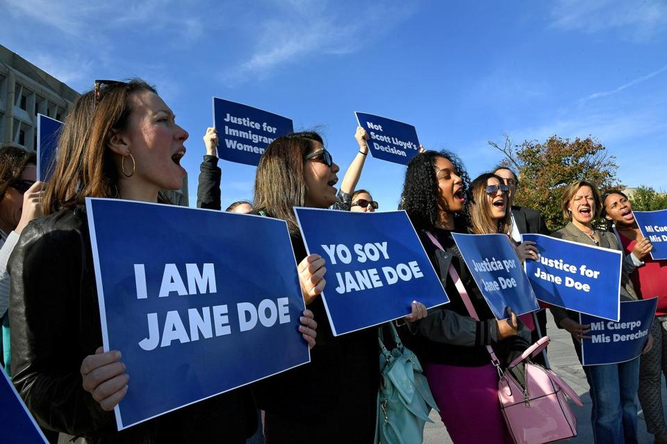 Georgeanne Usova of the American Civil Liberties Union, left, and others protest on Oct. 20 against the Trump administration's policy to block detained undocumented teens from accessing abortion services. MUST CREDIT: Washington Post photo by Michael S. Williamson