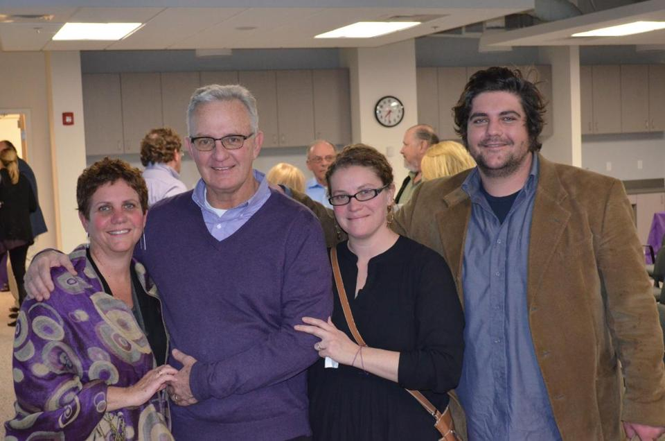 Judy and Steve Johanson (left) with their daughter Carly and son Luke at the Alzheimer's Association's office in Waltham in April 2016.