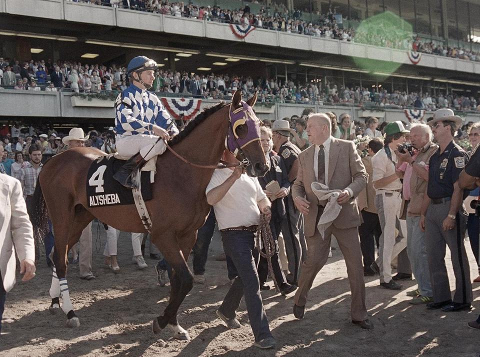 Mr. Van Berg (right) accompanied Alysheba and jockey Chris McCarron in 1987 after they failed in their bid for racing's Triple Crown. Alysheba finished fourth in the Belmont Stakes in Elmont, N.Y.