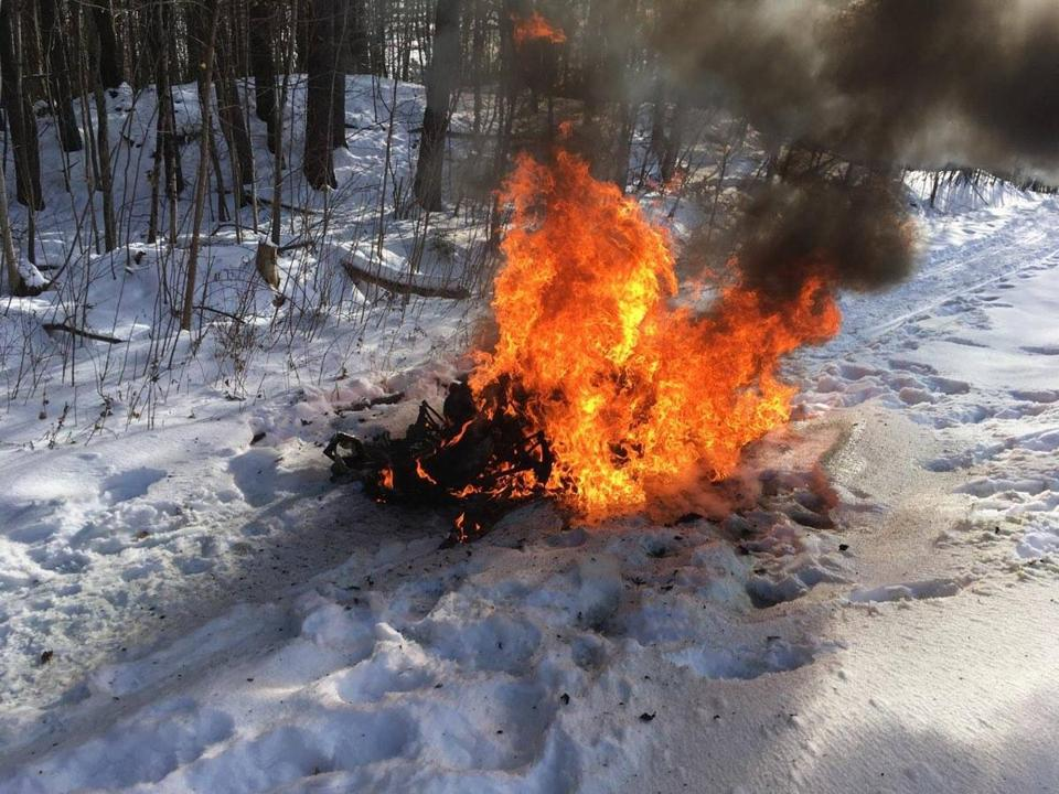 A Massachusetts man's snowmobile caught on fire in Wolfeboro, N.H., on Wednesday afternoon.