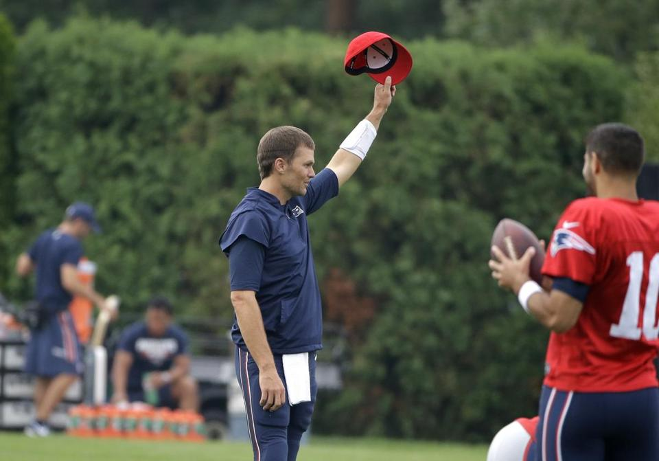 "New England Patriots' Tom Brady removes his hat as a crowd of spectators sing ""Happy Birthday"" to the quarterback at NFL football training camp, Thursday, Aug. 3, 2017, in Foxborough, Mass. Brady turned 40-years-old Thursday, Aug. 3, 2017. (AP Photo/Steven Senne)"