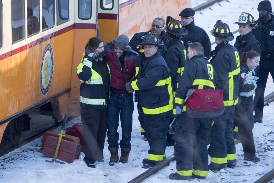 Firefighters helped injured passengers off of a Mattapan high-speed trolley after it crashed near Cedar Grove Station on Dec. 29.