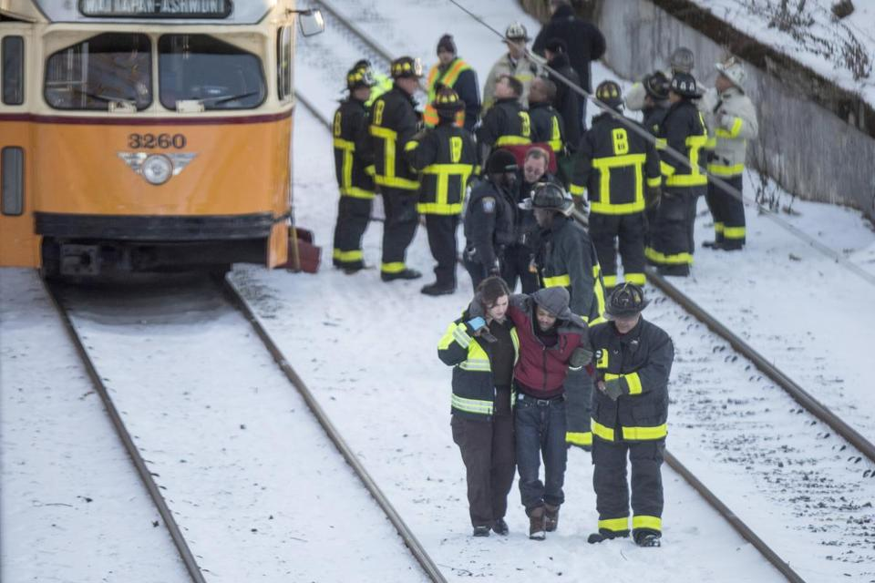 Firefighters helped injured passengers off of a Mattapan high-speed MBTA trolley after it crashed near Cedar Grove station.
