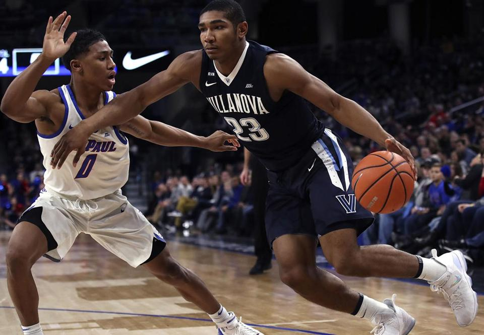 Villanova's Jermaine Samuels, right, is guarded by DePaul's Justin Roberts during the first half of an NCAA college basketball game Wednesday, Dec. 27, 2017, in Chicago. (AP Photo/Jim Young)