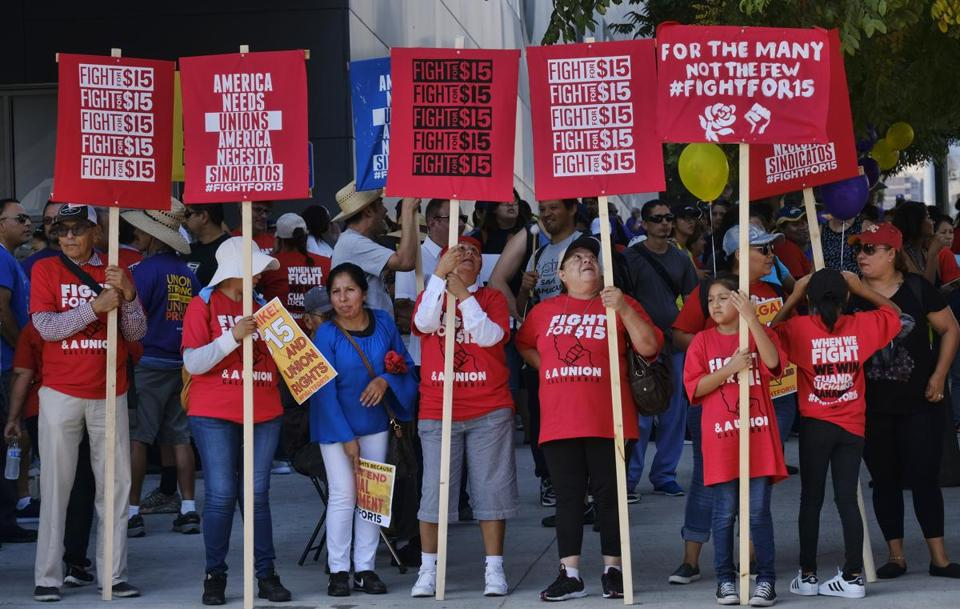 Union workers and minimum wage activists rallied on Labor Day in Los Angeles and other cities.