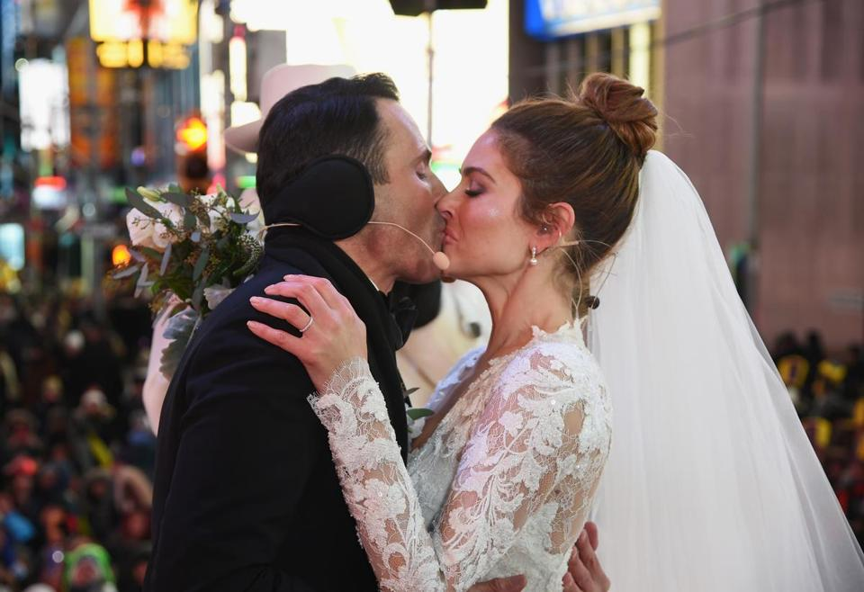 Keven Undergaro and his new bride, TV star Maria Menounos, kissed after exchanging vows.