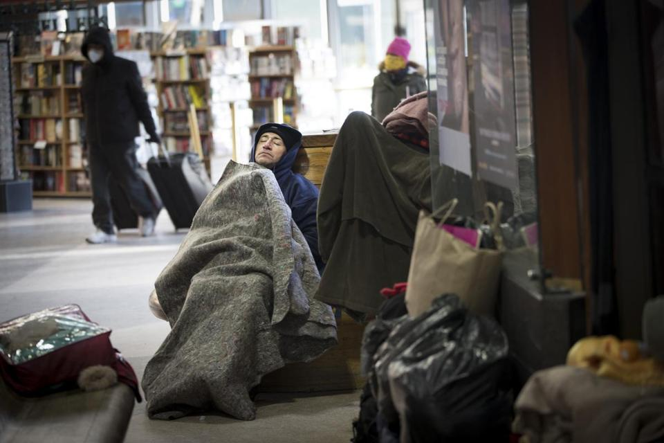 "Jose Jelgado, a homeless man, rested at South Station Monday. ""I try to survive the best I can,"" he said."