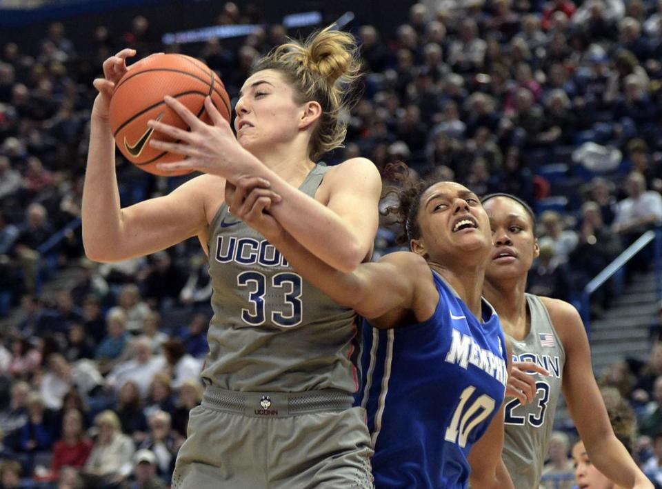 Connecticut's Katie Lou Samuelson (33) fights for a rebound against Memphis' Cheyenne Creighton (10) in the second half of an NCAA college basketball game Sunday, Dec. 31, 2017, in Hartford, Conn. (AP Photo/Stephen Dunn)