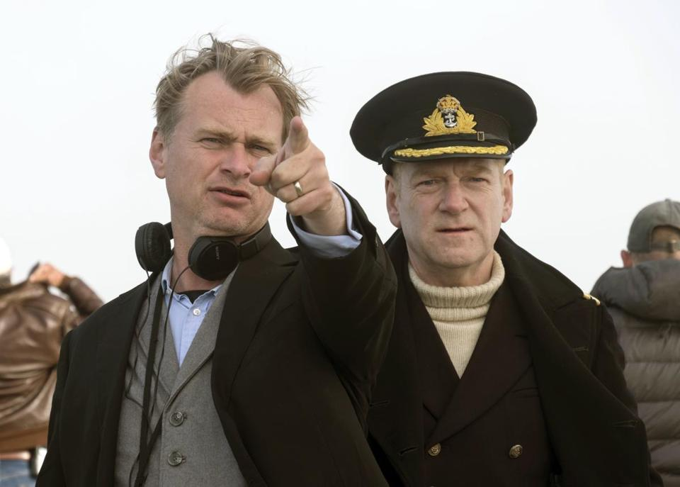 Directors like Christopher Nolan (left) are starting to ban cellphones from movie sets.