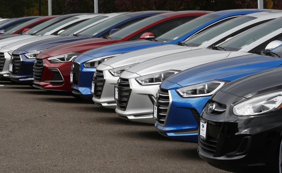 In this Friday, Oct. 6, 2017, photo, a line of 2018 Accents, Elantras and Sonatas sit at a Hyundai dealership in the south Denver suburb of Littleton, Colo. On Friday, Dec. 1, 2017, automakers report U.S. sales of new vehicles in November. (AP Photo/David Zalubowski)
