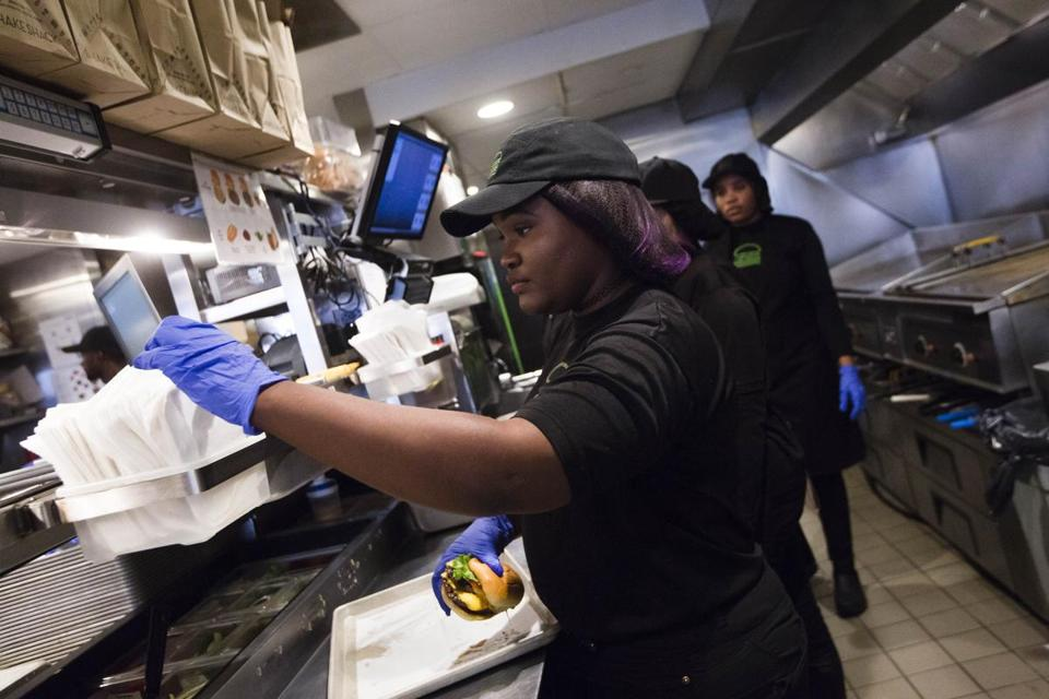 Djennyfer Joseph, who is from Haiti, filled an order at the Shake Shack on Newbury Street.