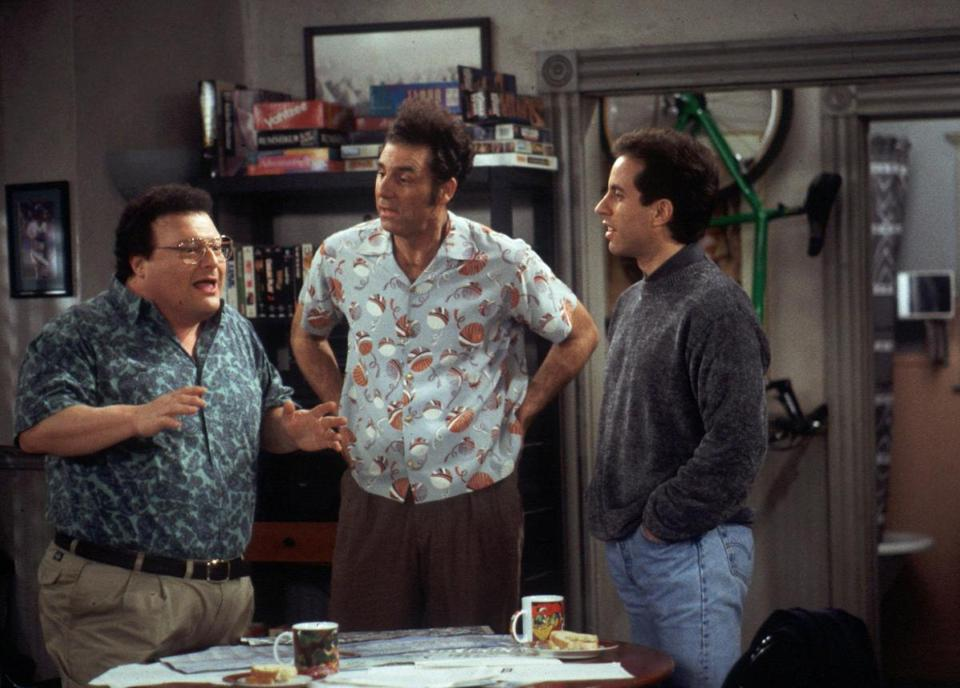 "Newman (Wayne Knight), left, and Kramer (Michael Richards), center, explain their new idea of bringing a rickshaw business to New York City to Jerry (Jerry Seinfeld) in this scene from a 1998 episode of NBC's hit sitcom ""Seinfeld."" Knight is one of the ""Seinfeld"" supporting players who deserve apprecation as stellar second bananas.(AP Photo/Joey DelValle, NBC) -- Library Tag 05122002 Arts & Entertainment 24crit"
