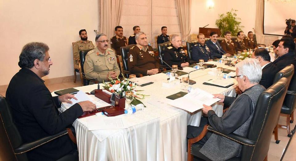 AFP/Getty Images Pakistani Prime Minister Shahid Khaqan Abbasi (left) addressed the National Security Council meeting in Islamabad.