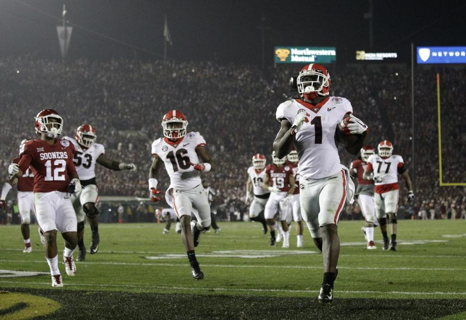 Georgia running back Sony Michel (1) scores a touchdown in overtime against Oklahoma in the Rose Bowl NCAA college football game, Monday, Jan. 1, 2018, in Pasadena, Calif. Georgia won 54-48. (AP Photo/Jae C. Hong)