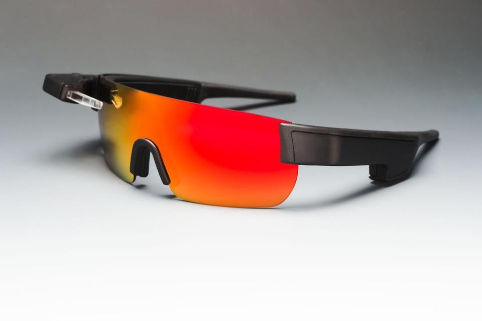 "Westborough-based Kopin Corp. has been developing ""augmented reality"" technology since 1991. Its latest product, Solos ""smart glasses,"" shows cyclists information about their workout on a tiny digital display."
