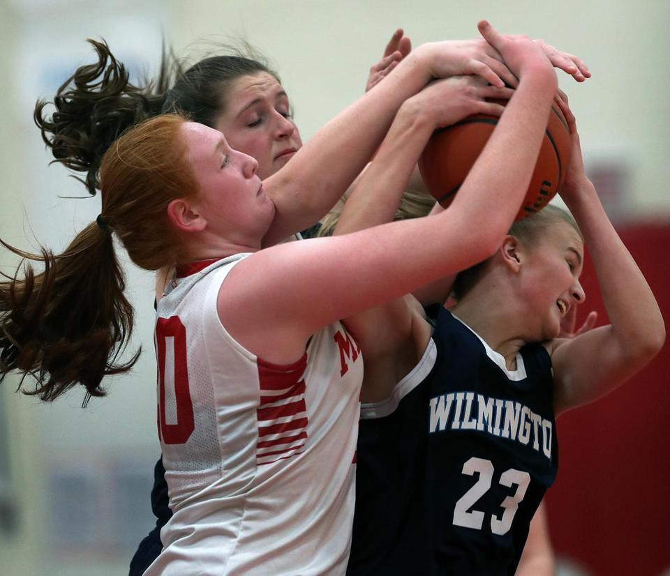 Melrose, MA 1-2-18: Melrose's Samantha Dewey (left) battles with Wilmington's Morgan Bresnahan (center) and Kylie DuCharme (right) for a first half rebound. Wilmington visited Melrose in a Girl's High School basketball game. (Jim Davis/Globe Staff)