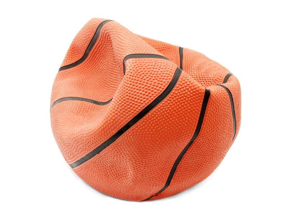 Broken basketball isolated on white background