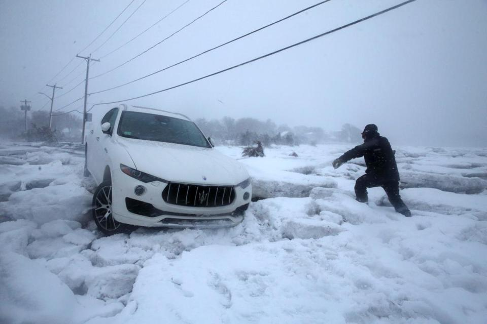SSteve Corsano investigated an abandoned vehicle trapped in sea ice on Bailys Causeway during the storm in Scituate.