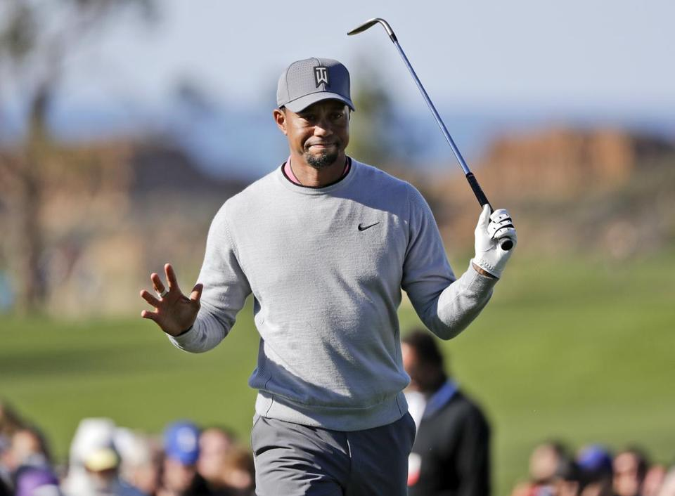 FILE - In this Jan. 27, 2017, file photo, Tiger Woods reacts after hitting out of the rough on the ninth hole of the North Course during the second round of the Farmers Insurance Open golf tournament at Torrey Pines Golf Course in San Diego. Woods announced Thursday, Jan. 4, 2018, that he is playing twice in California over the next six week as he begins another comeback on the PGA Tour from back surgery. He will play the Farmers Insurance Open on Jan. 25 at Torrey Pines, and the Genesis Open at Riviera in Los Angeles that starts on Feb. 15. (AP Photo/Gregory Bull, File)
