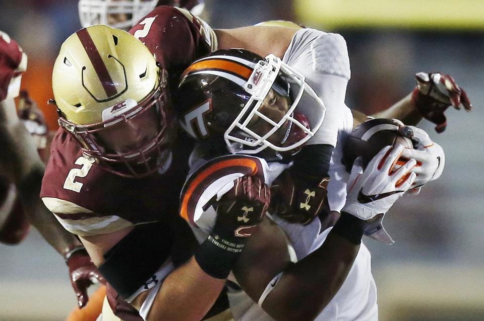 Boston College's Zach Allen (2) tackles Virginia Tech's Travon McMillian during the second half of an NCAA college football game in Boston, Saturday, Oct. 7, 2017. Virginia Tech won 23-10. (AP Photo/Michael Dwyer)