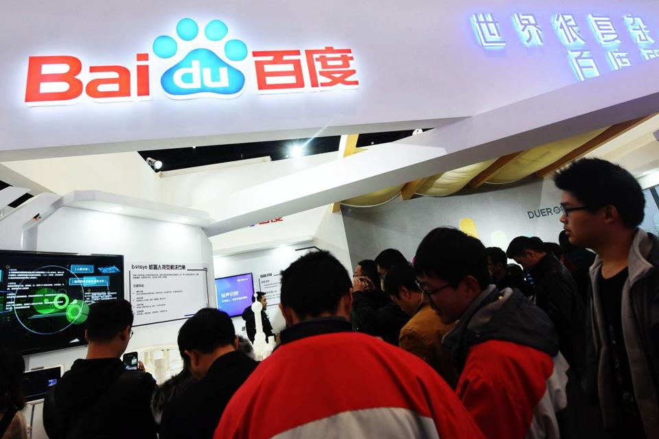 This photo taken on December 4, 2017 shows people visiting the Baidu booth during the 4th World Internet Conference in Wuzhen in China's eastern Zhejiang province. The conference is held in Wuzhen from December 3 to 5. / AFP PHOTO / - / China OUT-/AFP/Getty Images