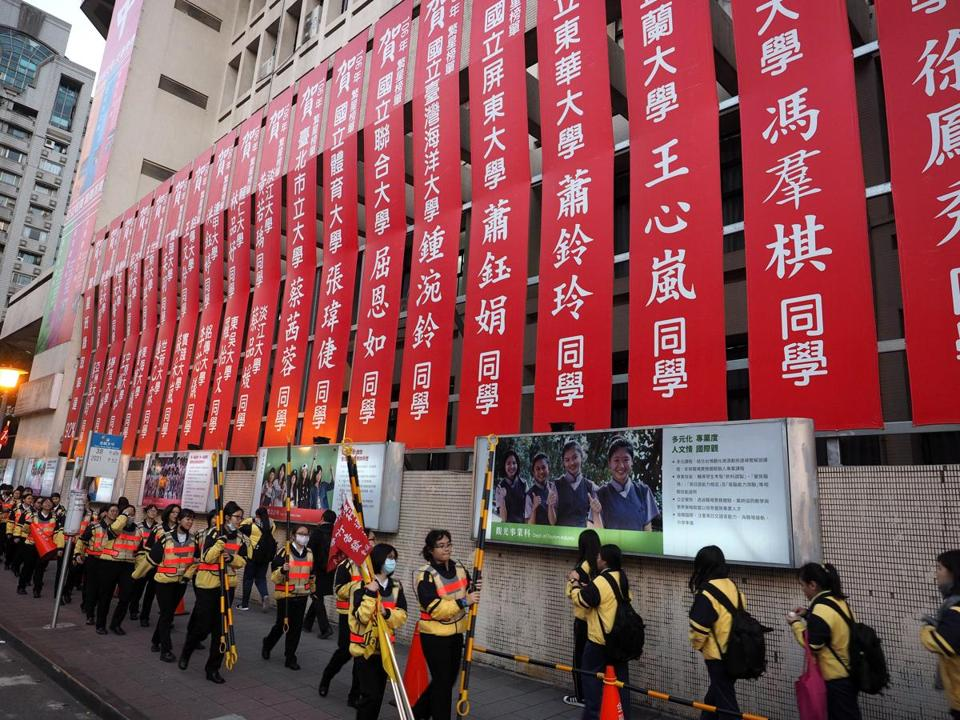 Red banners congratulated students on successfully entering universities, seen outside the Jinou Girls High School in Taipei.