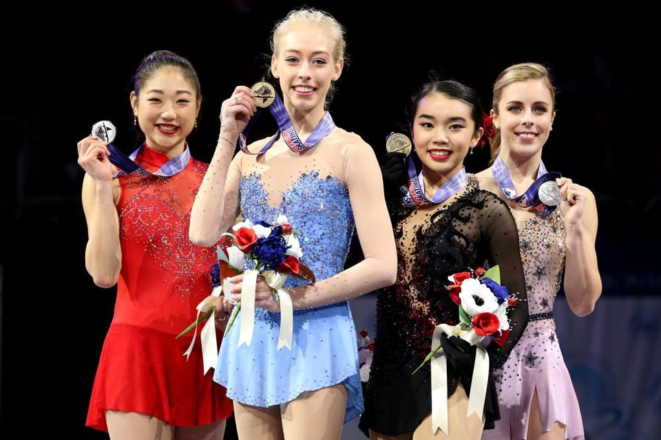 SAN JOSE, CA - JANUARY 05: Mirai Nagasu, Bradie Tennell, Karen Chen and Ashley Wagner pose on the medals podium after the Championship Ladies during the 2018 Prudential U.S. Figure Skating Championships at the SAP Center on January 5, 2018 in San Jose, California. (Photo by Matthew Stockman/Getty Images)