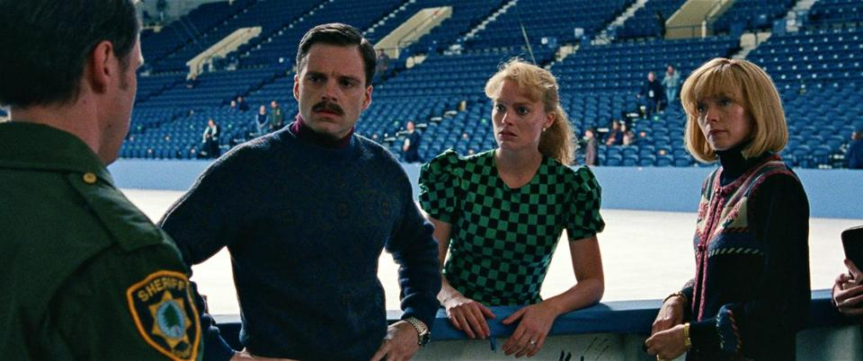 "Sebastian Stan (second from left) plays Jeff Gillooly flanked by Margot Robbie as Tonya Harding in a scene from ""I, Tonya."""