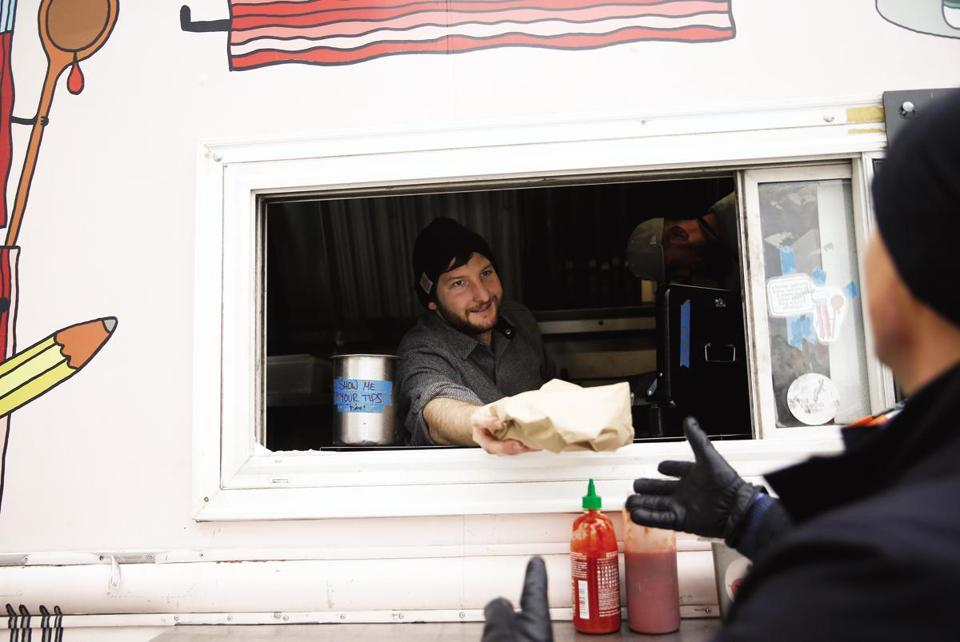 "Warmer temperatures Monday attracted more folks to the streets and to such food haunts as The Bacon Truck. ""It's a nice morale boost being able to feel my toes again,"" said Sam Williams, the truck's owner."