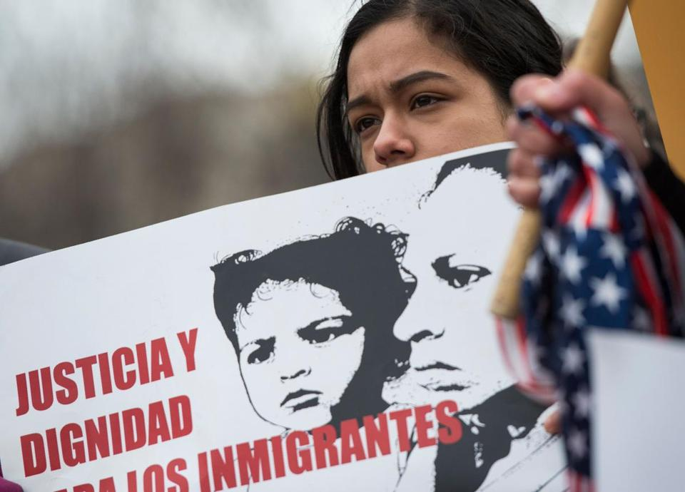 A young girl looked on as immigrants and activists protested Tuesday near the White House in the wake of the DHS decision.