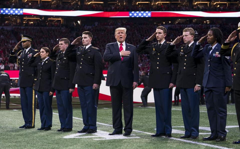 President Donald Trump sang along to the national anthem while attending the college football championship game Monday.