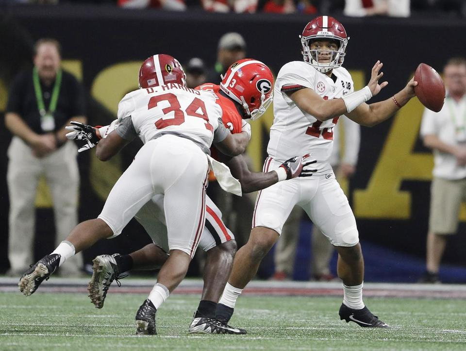 Alabama quarterback Tua Tagovailoa drops back to pass in the second half.