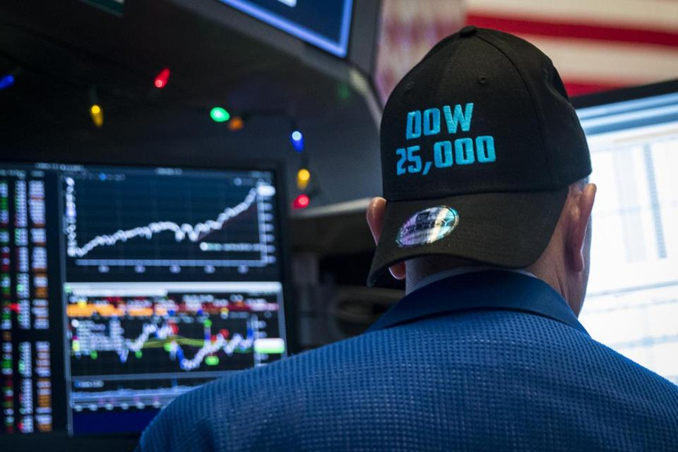 A trader on the floor of the New York Stock Exchange used a baseball cap to mark the reaching of a milestone on Jan. 4.
