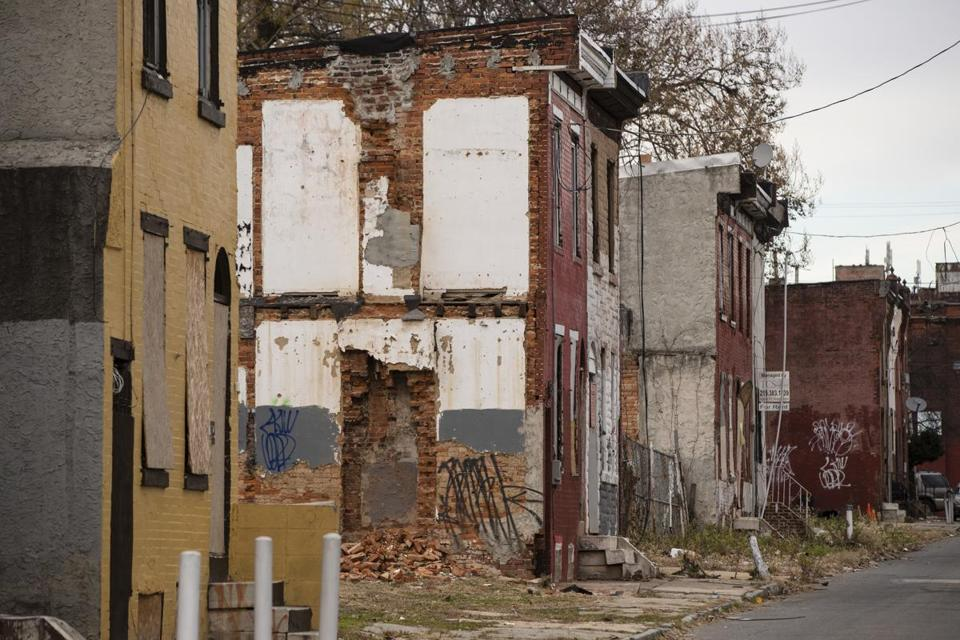 Shown are blighted and abandoned row homes in Philadelphia, Wednesday, Dec. 6, 2017. (AP Photo/Matt Rourke)