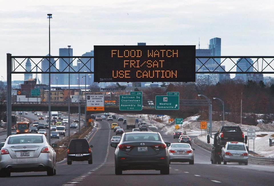 A sign warning of potential flooding this weekend appeared above Route 93 southbound.