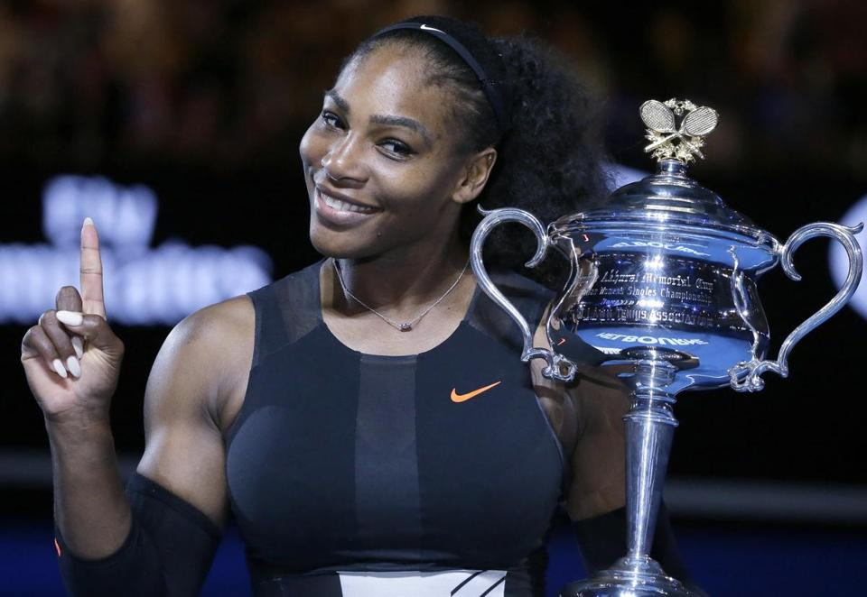 FILE - In this Jan. 28, 2017, file photo, Serena Williams holds up a finger and her trophy after defeating her sister, Venus, in the women's singles final at the Australian Open tennis championships in Melbourne, Australia. Serena Williams tells Vogue that she dealt with a medical scare right after the birth of her daughter. In a story in the magazine's February issue and posted Wednesday, Jan. 10, 2018, on Vogue.com , Williams discusses developing several small blood clots in her lungs while in the hospital after Alexis Olympia Ohanian Jr. was born in September. (AP Photo/Aaron Favila, File)