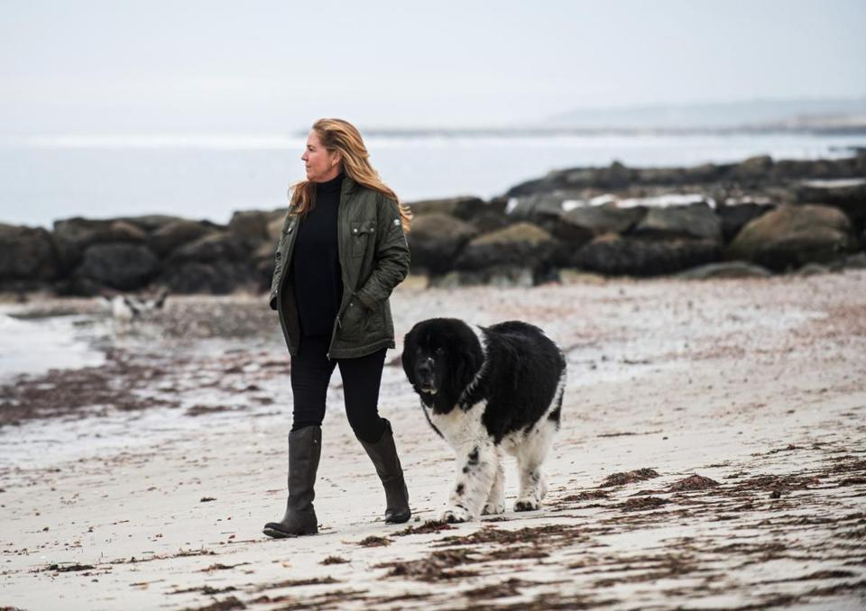 ATF Special Agent SherryAnn Quindley walked with Dublin, her 10-year-old Newfoundland, near Parker River Beach in South Yarmouth in January.