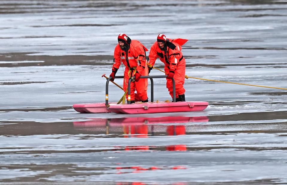 Boston Police on a pontoon raft searched Jamica Pond in response to a report that an individual had fallen through the ice.