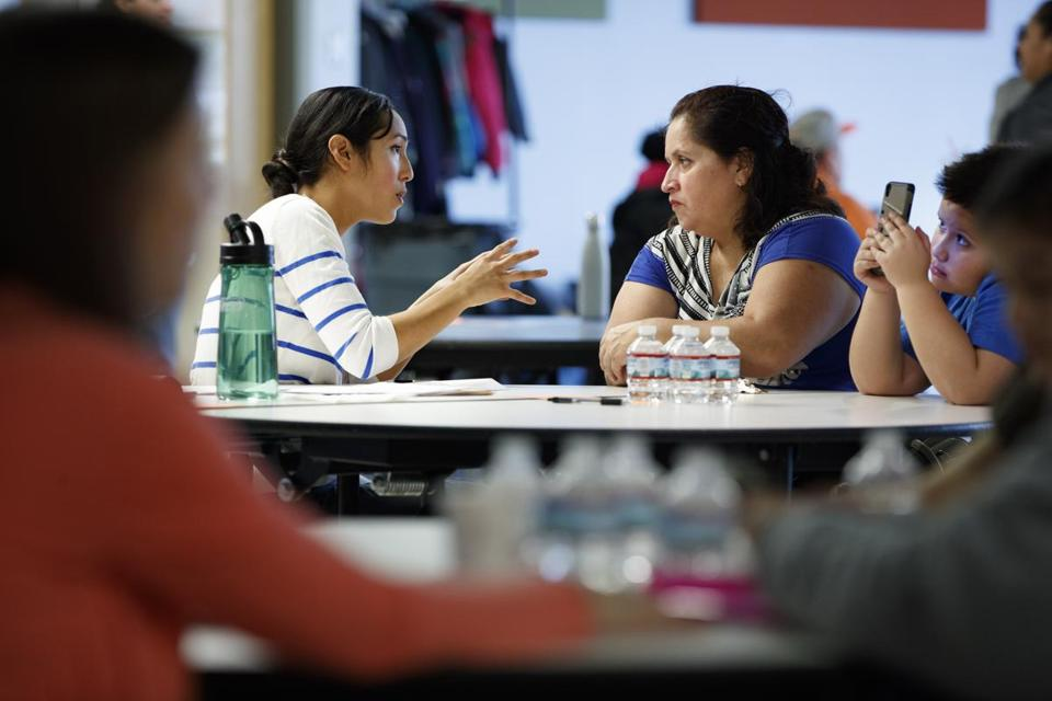 Immigration lawyer Cindy Zapata (left) spoke with Maria Aguilar on Saturday at a legal clinic hosted by Somerville and Centro Presente.