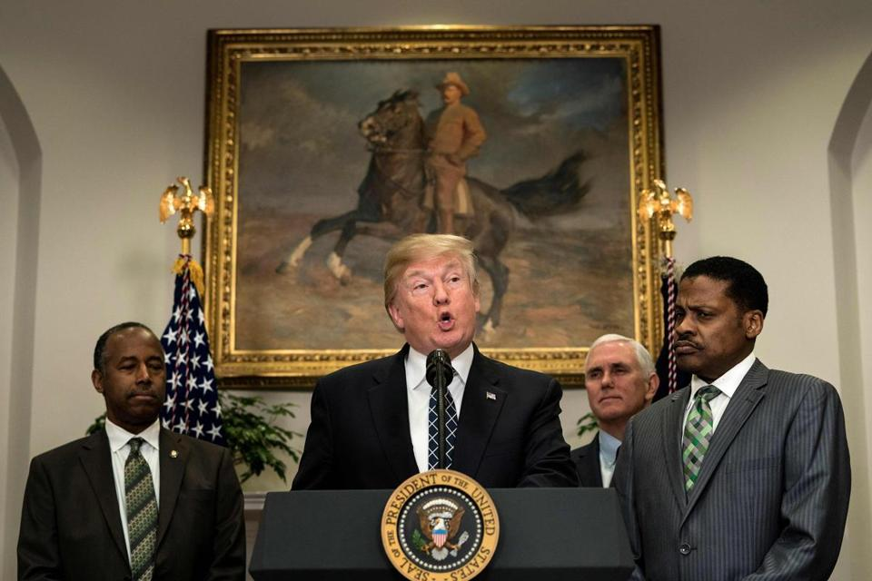 TOPSHOT - US Secretary of Housing and Urban Development Ben Carson (L), US Vice President Mike Pence (2R) and Isaac Newton Farris Jr. (R) listen while US President Donald Trump speaks during an event about Martin Luther King Jr. in the Roosevelt Room of the White House January 12, 2018 in Washington, DC. / AFP PHOTO / Brendan SmialowskiBRENDAN SMIALOWSKI/AFP/Getty Images