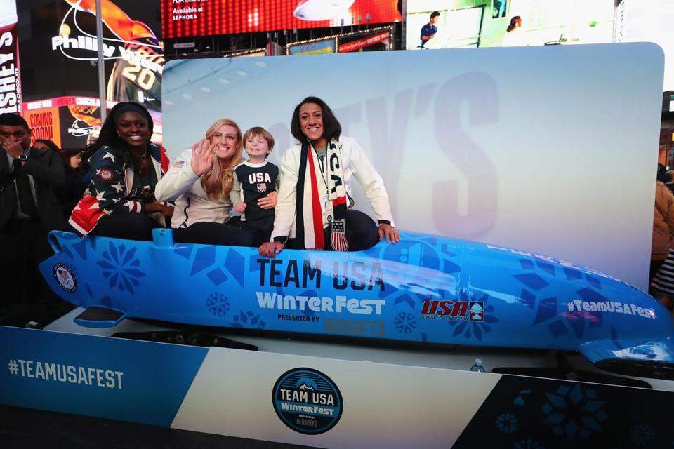 From left, bobsledders Aja Evans, Jamie Greubel Poser, and Elana Meyers Taylor pose for a photo at a Team USA celebration in November.