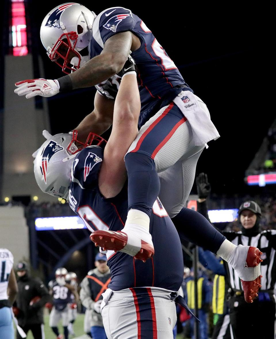 David Andrews hoisted James White after White's 5-yard touchdown catch.